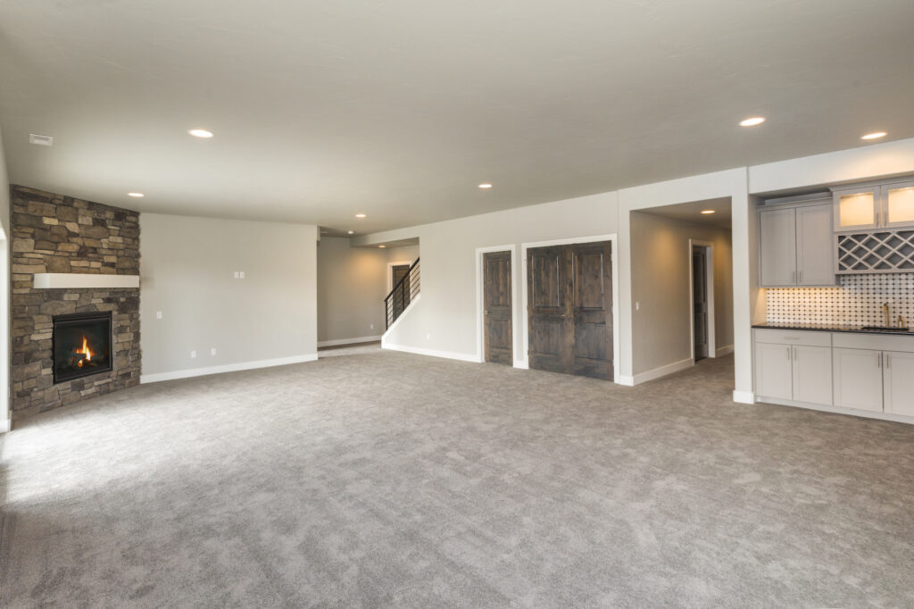a remodeled basement with a wide open floorplan