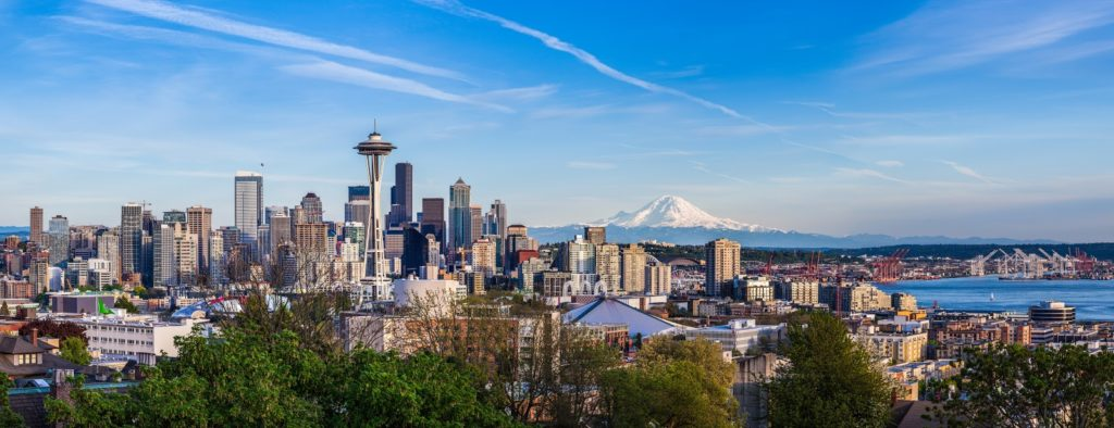 Panorama view of Seattle downtown skyline and Mt. Rainier, Washington.
